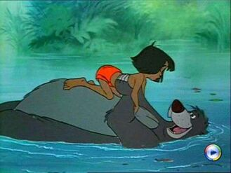 Jungle Book Baloo the Bear and Mowgli in the river