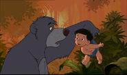 Ranjan is telling Baloo the bear Mowgli and Shanti are in danger