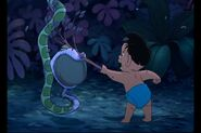 Ranjan is beating up Kaa the python with a stick