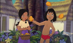 Shanti is impressed to see Mowgli juggle mangos