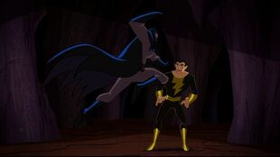 Batman attempts to stop Black Adam from unleashing the Djinn.