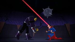 In the arena, Superman breaks Mongul's mace.