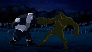 Solomon Grundy and Swamp Thing battle in the moonlight.