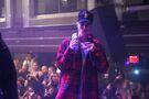 Justin Bieber holding his phone at LIV December 2015