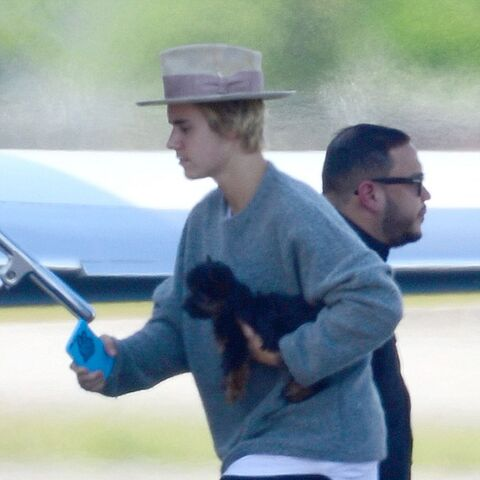 Justin Bieber boarding a private jet with Esther.