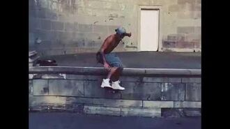 Justin Bieber doing an ollie on his skateboard