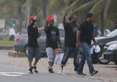 Justin Bieber and friends showing middle finger