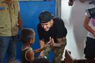 Justin Bieber high-fiving a child