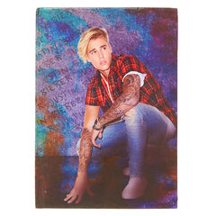 Justin Bieber in Flannel Notebook<br /><br />Write down your thoughts and fantasies about Justin Bieber in this notebook. A crouching Justin Bieber is wearing red flannel against a purple and blue ombre background decorates the cover and every lined page inside is watermarked with his name.