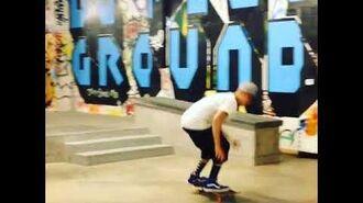 Justin Bieber doing a kickflip on his skateboard