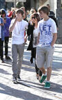 Justin Bieber walking with his mom and his friend