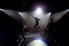 Justin Bieber jumping on stage at My World Tour