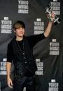 Justin Bieber poses with MTV VMA award 2010