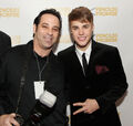 Justin Bieber and photographer at Pencils of Promise gala