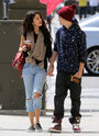 Justin Bieber holding hands with Selena Gomez