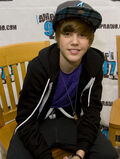 Justin Bieber sitting on a chair November 2009