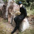Justin Bieber sitting on a rock