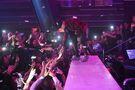 Justin Bieber touching fan's hands at LIV