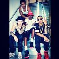 Justin Bieber with friends sitting on stairs