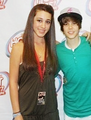 Justin Bieber at Hot Hits 95.7 with a fan