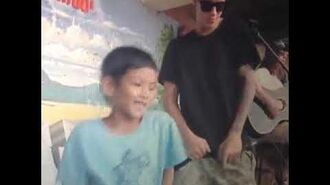 Justin Bieber playing with children