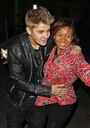 Justin Bieber steps out with red lipstick on his cheek and hugs fan