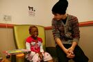 Justin Bieber with a young fan at Children's National Medical Center