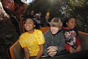 Justin Bieber in a rollercoaster in Disney World 2009