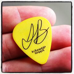 Robert holding a signed Justin Bieber plectrum