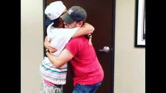 Justin Bieber hugging Scooter Braun