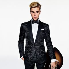 Tuxedo jacket, $2,495, shirt, $595, bow tie, $155, pocket square, $75, and tuxedo pants, $895, by Ralph Lauren