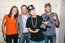 Justin Bieber holding RIAA Diamond Award