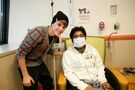 Justin Bieber with a patient at Children's National Medical Center