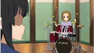 Mio over Ritsu's new energy