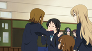 Mio's face gets fixed