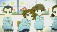 Yui playing castanets in kindergarten