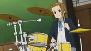 Ritsu playing drums