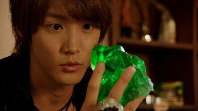 File:Haruto holding a green magic stone.jpg