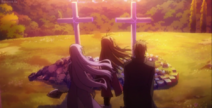 Ai standing in front of her parents grave