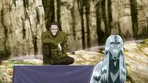 Jian-Feng sitting next to a waterfall