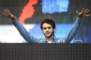 Zedd with his arms out while performing at Ultra Music Festival 2014