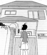 Futuki looking at his home
