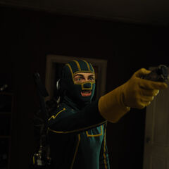 Kick-Ass using his taser against Rasul.