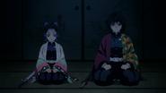 Shinobu and Giyu speaking with Kagaya
