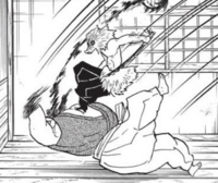 Inosuke defeating the Horned Demon