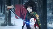 Giyu holds Nezuko