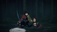 Giyu protecting Nezuko from Shinobu