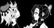Shinobu holding Doma's head