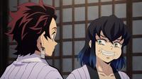 Inosuke eating Tanjiro's food