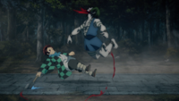 Tanjiro slashes the Temple Demon